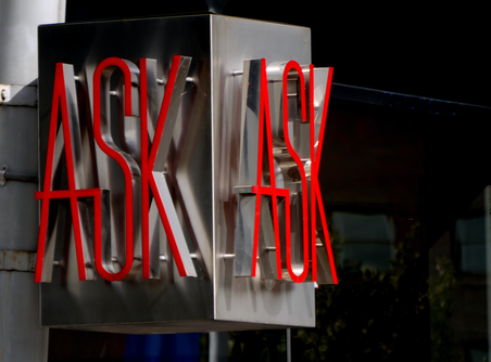 "Image of neon sign with the word ""ASK"""